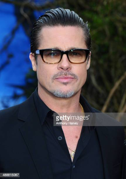 """Brad Pitt attends a private reception as costumes and props from Disney's """"Maleficent"""" are exhibited in support of Great Ormond Street Hospital at..."""