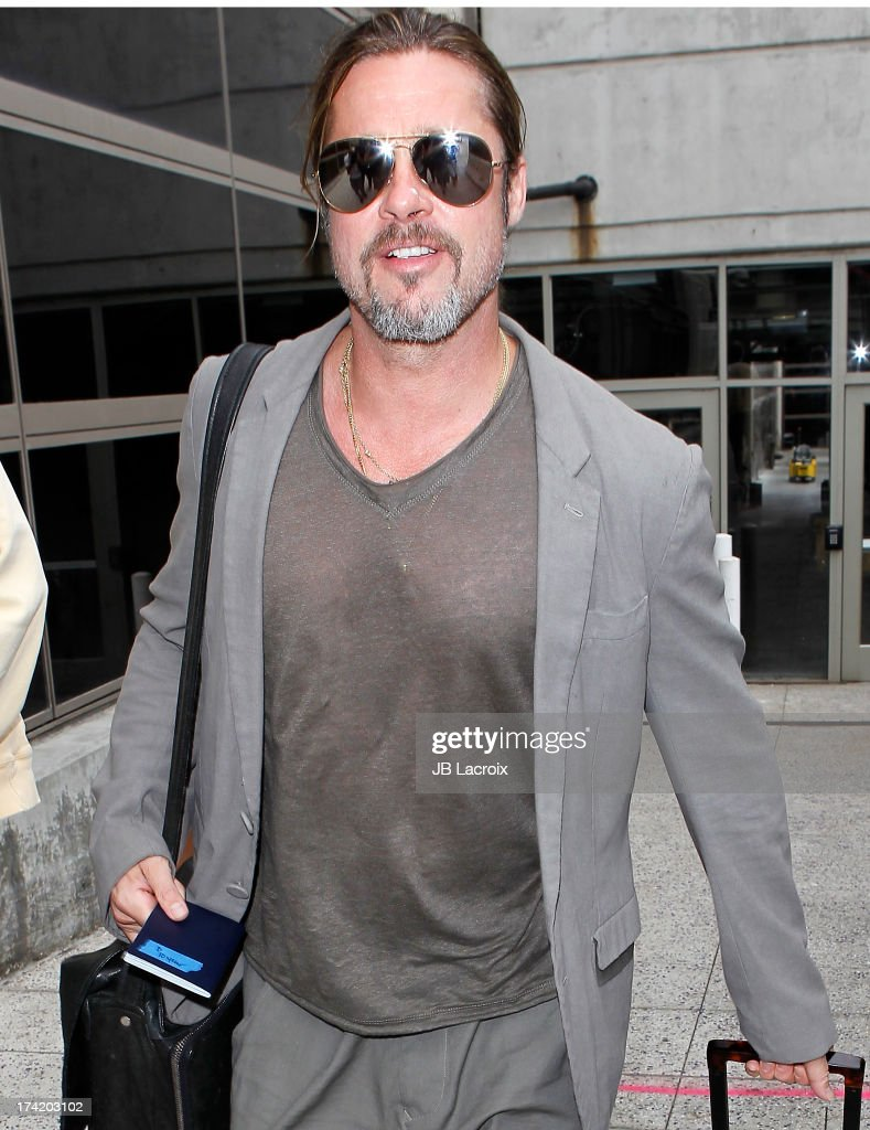 Brad Pitt is seen arriving at LAX Airport on July 21, 2013 in Los Angeles, California.