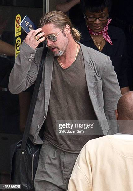 Brad Pitt is seen at Los Angeles International Airport on July 21 2013 in Los Angeles California