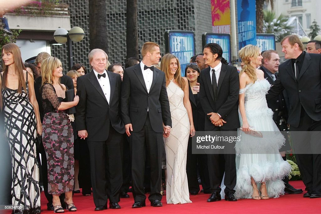 Brad Pitt, Jennifer Aniston, Orlando Bloom and Diane Kruger along with other actors from the movie 'Troy' attend the 57th Cannes Film Festival screening of film 'Troy' at the Grand Theatre Lumiere on May 13 2004 in Cannes, France. Aniston wears a dress by Versace.
