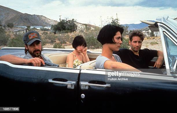 Brad Pitt Juliette Lewis Michelle Forbes and David Duchovny ride in a car in a scene from the film 'Kalifornia' 1993