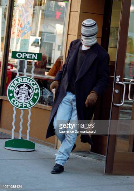 Brad Pitt leaves a Magazine Shop on Lexington Avenue spots photographers and covers face with his wool cap December 11 1995