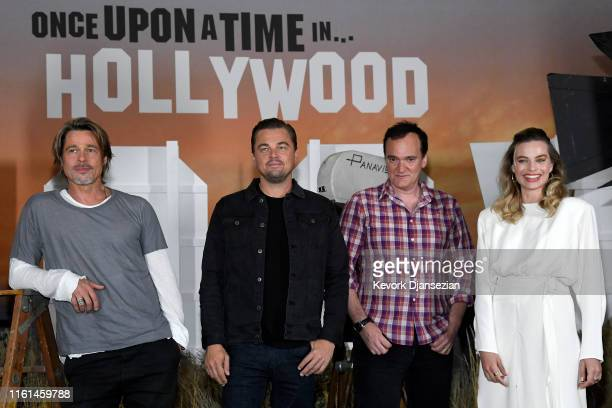 """Brad Pitt, Leonardo DiCaprio, director Quentin Tarantino and Margot Robbie attend the photo call for Columbia Pictures' """"Once Upon A Time In..."""