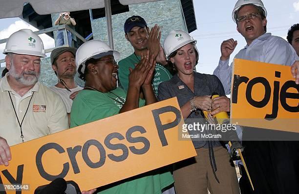 Brad Pitt Pam Dashiell former President of Holy Cross Neighbourhood Association Kelly R Caffarelli Executive Director for Home Depot and Matt...