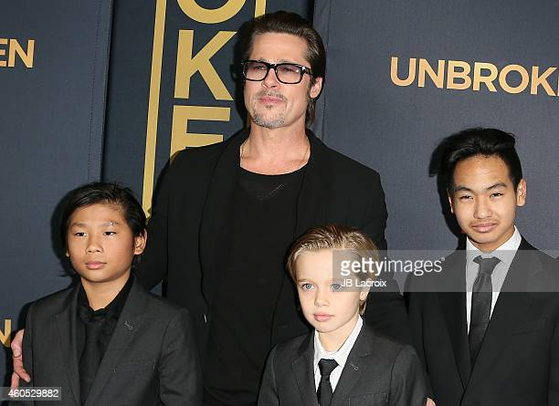 Brad Pitt Pax Thien JoliePitt Shiloh Nouvel JoliePitt and Maddox JoliePitt attend the Unbroken Los Angeles premiere held at the TCL Chinese Theatre...
