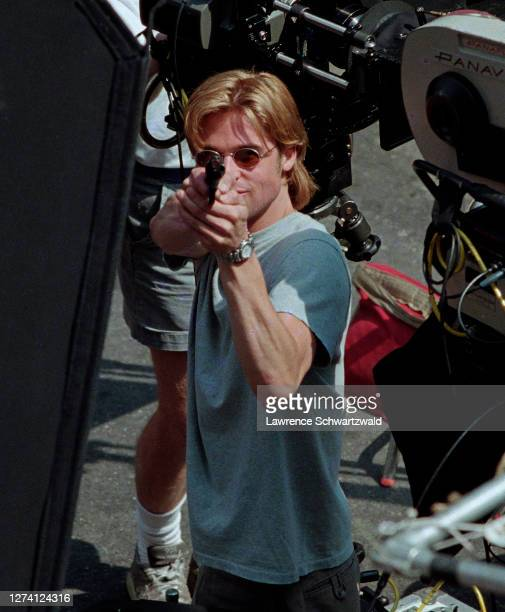 Brad Pitt pointed a gun loaded with blanks at photographers on a second story balcony of a Law office overlooking the downtown set of Devil's Own...