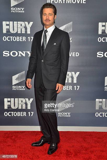 Brad Pitt poses for photographers on the red carpet during the The Fury Washington DC premiere at The Newseum on October 15 2014 in Washington DC