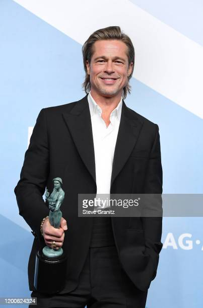 """Brad Pitt poses in the press room after winning the award for Outstanding Performance by a Male Actor in a Supporting Role for """"Once Upon a Time in..."""