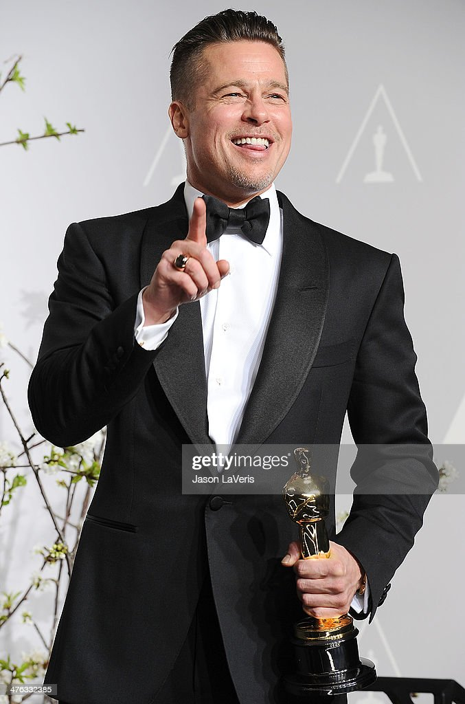 Brad Pitt poses in the press room at the 86th annual Academy Awards at Dolby Theatre on March 2, 2014 in Hollywood, California.