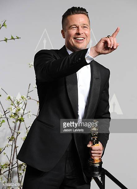 Brad Pitt poses in the press room at the 86th annual Academy Awards at Dolby Theatre on March 2 2014 in Hollywood California
