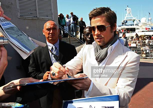 Brad Pitt signs autographs while attending the Inglourious Basterds Photocall held at the Palais Des Festivals during the 62nd International Cannes...