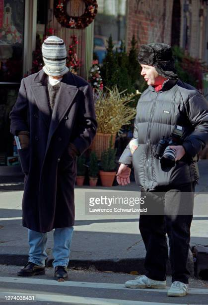 Brad Pitt spotted in a Magazine Shop on Lexington ave by photographers Brad covers his face and is engaged by famous photographer Mark Saunders in...