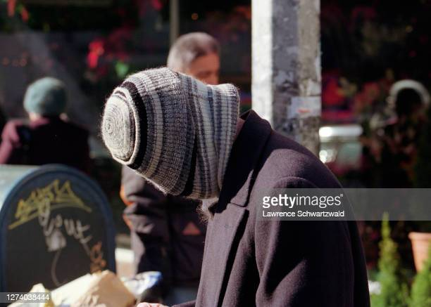 Brad Pitt spotted in a magazine shop on Lexington Avenue then covers his face with a knit cap when he spots photographers in NYC December 1 1995...