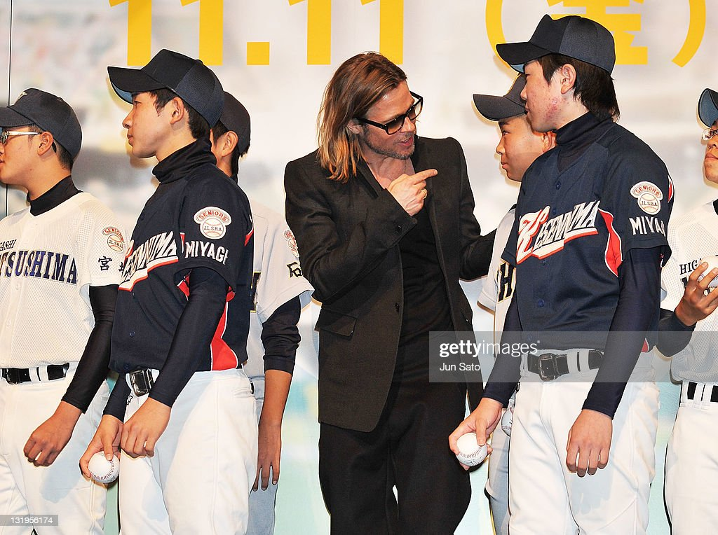 Brad Pitt talks to children from a local school which was affected by the tsunami earlier this year, during the premier of 'Moneyball' at Tokyo International Forum on November 9, 2011 in Tokyo, Japan. The film will open on November 11 in Japan.