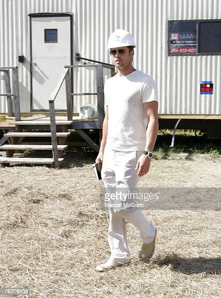 Brad Pitt walks at the Global Green USA's first house project at the Holy Cross Neigbourhood association project in the 9th ward district on August...