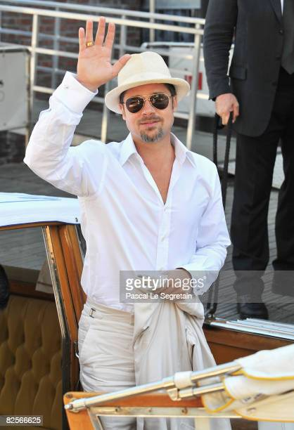 Brad Pitt waves as he arrives for the 'Burn After Reading' Photocall part of the 65th Venice Film Festival at Palazzo del Casino on August 27, 2008...