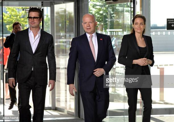 Brad Pitt, William Hague and Angelina Jolie attend the Global Summit to end Sexual Violence in Conflict at ExCel on June 12, 2014 in London, England.