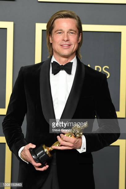 Brad Pitt winner of Actor in a Supporting Role award for Once upon a Time in Hollywood poses in the press room during the 92nd Annual Academy Awards...