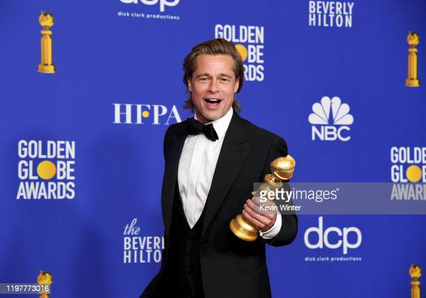 Brad Pitt, winner of Best Performance by a Supporting Actor in a Motion Picture, poses in the press room during the 77th Annual Golden Globe Awards...