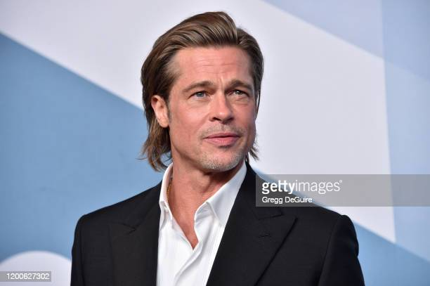 Brad Pitt winner of Outstanding Performance by a Male Actor in a Supporting Role for 'Once Upon a Time in Hollywood' poses in the press room during...