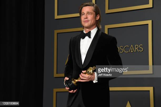 "Brad Pitt winner of the Actor in a Supporting Role award for ""Once Upon a Time…in Hollywood"" poses in the press room during the 92nd Annual Academy..."