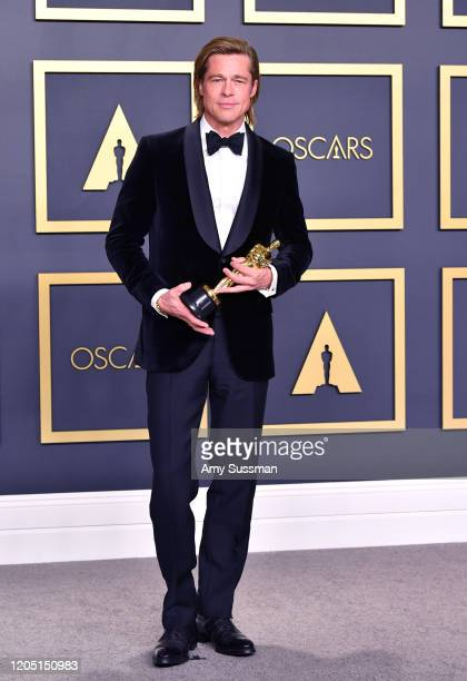 "Brad Pitt winner of the Actor in a Supporting Role award for ""Once upon a Timein Hollywood"" poses in the press room during the 92nd Annual Academy..."