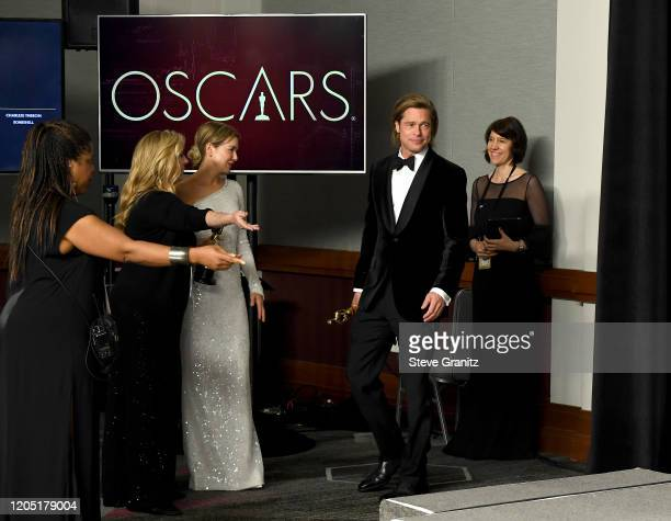 """Brad Pitt, winner of the Actor in a Supporting Role award for """"Once Upon a Time in Hollywood,"""" poses in the press room during the 92nd Annual Academy..."""