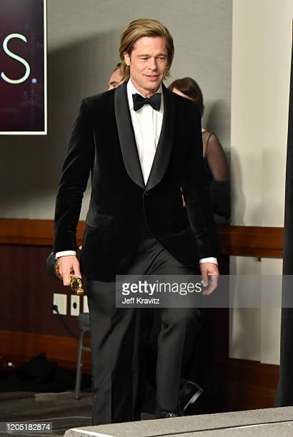 Brad Pitt winner of the Actor in a Supporting Role award for Once Upon a Time…in Hollywood walks into the press room during the 92nd Annual Academy...