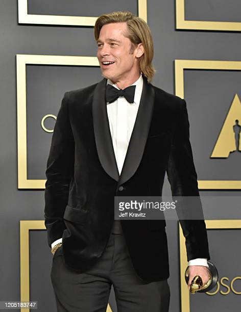 Brad Pitt winner of the Actor in a Supporting Role award for Once Upon a Time…in Hollywood poses in the press room during the 92nd Annual Academy...