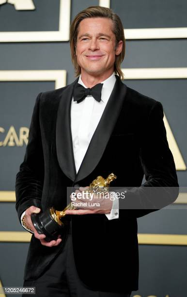 "Brad Pitt, winner of the Actor in a Supporting Role award for ""Once Upon a Time...in Hollywood"" poses in the press room during the 92nd Annual..."