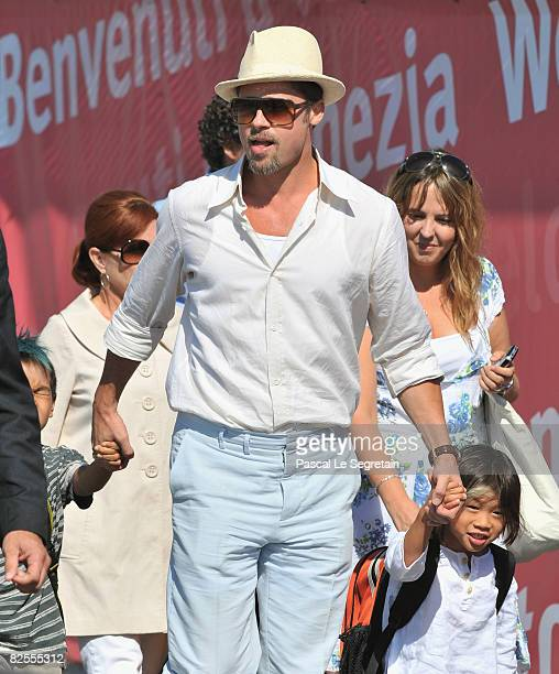 Brad Pitt with adopted son Maddox JoliePitt and Pax Thien JoliePitt leave Marco Polo Airport in Venice ahead of the 65th Venice Film Festival on...