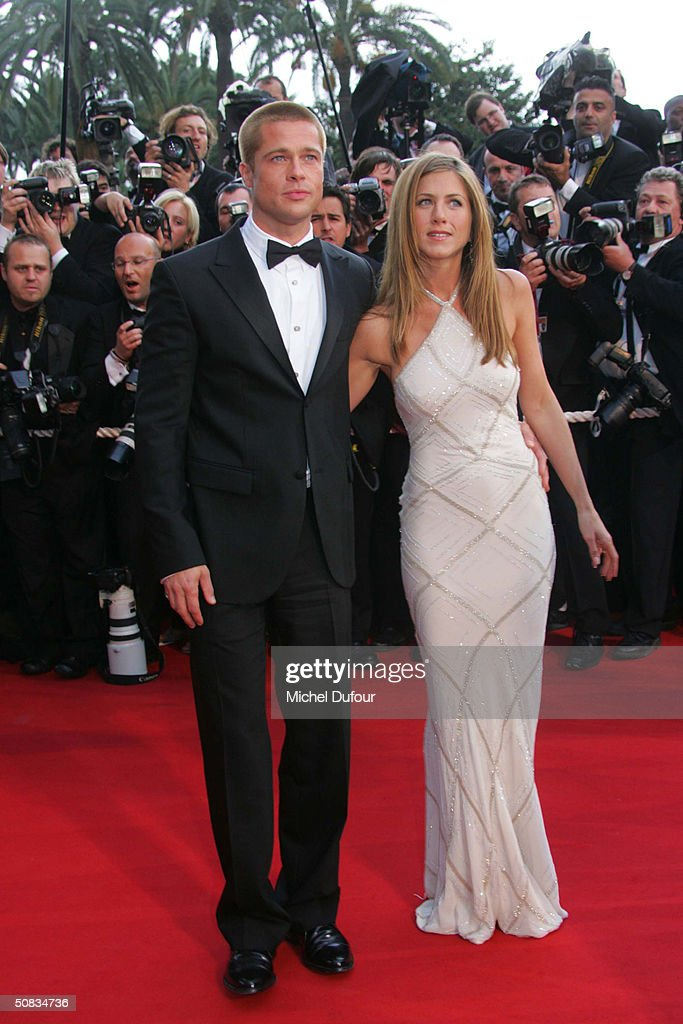 Brad Pitt with Jennifer Aniston attend the 57th Cannes Film Festival screening of film 'Troy' at the Grand Theatre Lumiere on May 13 2004 in Cannes, France. Aniston wears a dress by Versace.