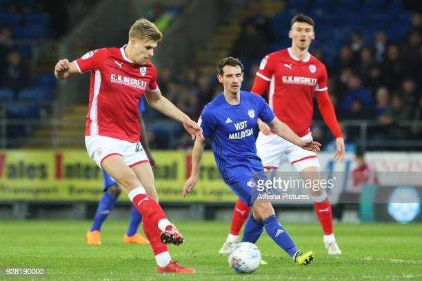 Brad Potts of Barnsley is challenged by Craig Bryson of Cardiff City during the Sky Bet Championship match between Cardiff City and Barnsley at the...