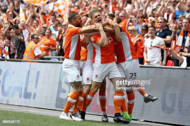 Brad Potts of Blackpool celebrates scoring his sides first goal with his Blackpool team mates during the Sky Bet League Two Playoff Final between...