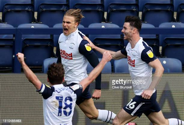 Brad Potts of Preston North End celebrates with Andrew Hughes and Ryan Ledson after scoring their side's first goal during the Sky Bet Championship...