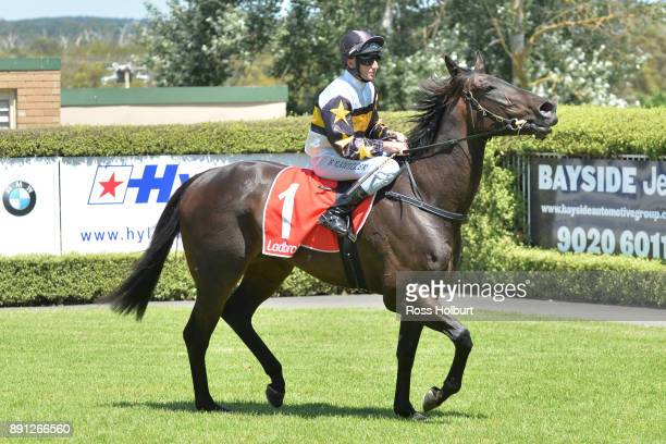 Brad Rawiller returns to the mounting yard on Fica Gal after winning the The Big Screen Company Hcp at Mornington Racecourse on December 13 2017 in...