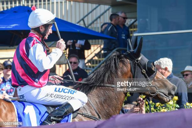 Brad Rawiller returns to the mounting yard on So You Dream after winning the Roll the Dice 0 58 Handicap at Bendigo Racecourse on October 20 2018 in...