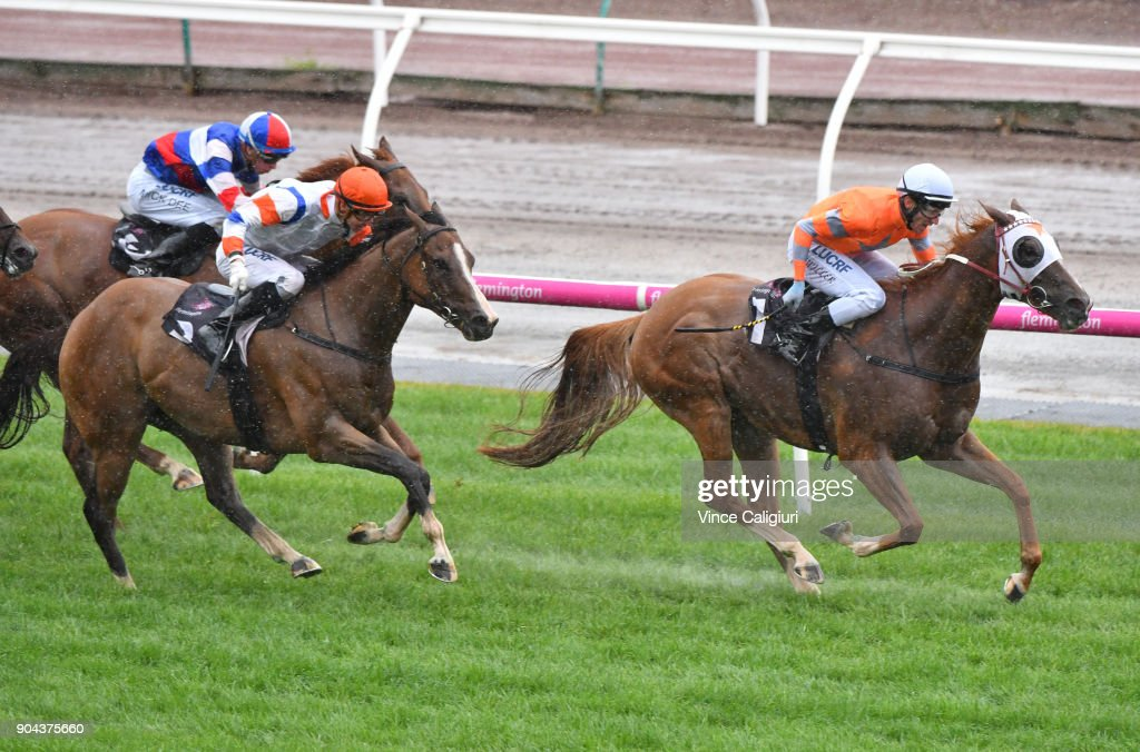 Brad Rawiller riding Burning Front defeats Jye McNeil riding Dollar For Dollar in Race 7, Chester Manifold Stakes at Flemington Racecourse on January 13, 2018 in Melbourne, Australia.