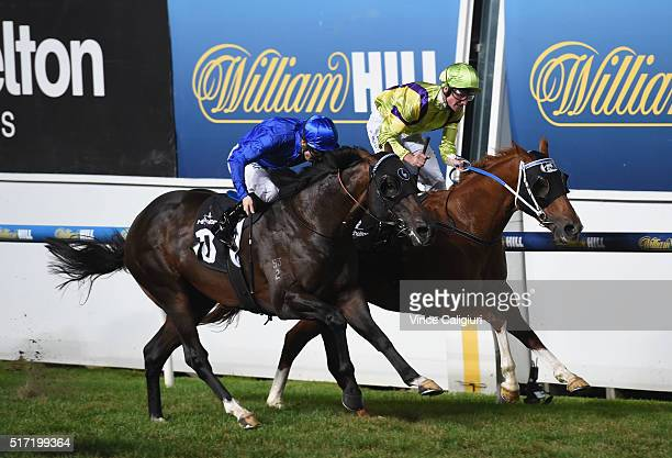 Brad Rawiller riding Flamberge defeats James McDonald riding Holler in Race 6 the Mitchelton Wines William Reid Stakes during Melbourne Racing at...