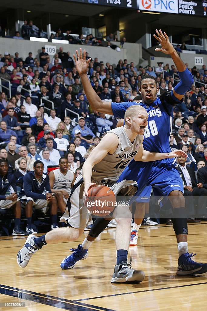 Brad Redford #12 of the Xavier Musketeers drives to the basket against D.J. Stephens #30 of the Memphis Tigers during the game at Cintas Center on February 26, 2013 in Cincinnati, Ohio. Xavier defeated Memphis 64-62.