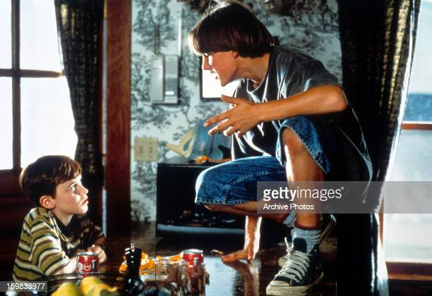 Brad Renfro and Joseph Mazzello talking in the dining room in a scene from the film 'The Cure' 1995
