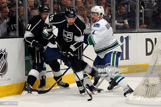 Brad Ricahrdson of the Los Angeles Kings skates with the puck against Keith Ballard of the Vancouver Canucks in Game Four of the Western Conference...