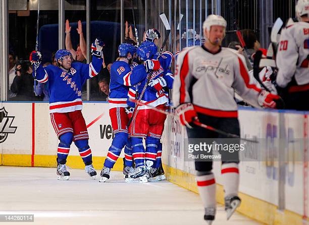 Brad Richards of the New York Rangers celebrates with his teammates after Michael Del Zotto scored a goal in the third period against the Washington...