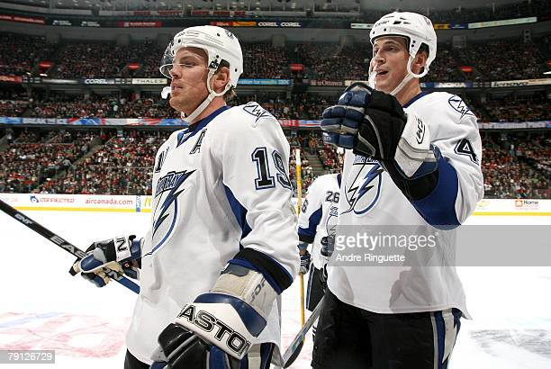 Brad Richards and Vincent Lecavalier of the Tampa Bay Lightning skate to the becnch to celebrate a first period goal against the Ottawa Senators at...