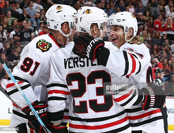 Brad Richards, Kris Versteeg and Patrick Kane of the Chicago Blackhawks celebrate Kane's second period goal against the Anaheim Ducks on November 28,...