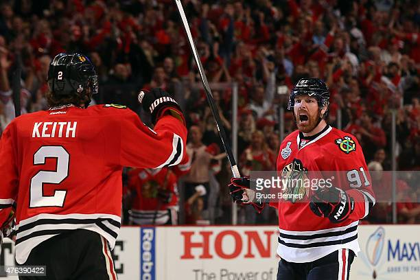 Brad Richards of the Chicago Blackhawks celebrates a first period goal with Duncan Keith against the Tampa Bay Lightning during Game Three of the...