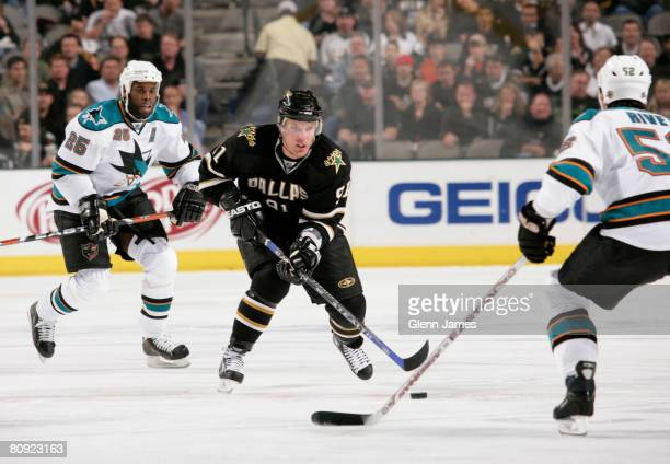 Brad Richards of the Dallas Stars skates against Craig Rivet of the San Jose Sharks during game three of the 2008 NHL Western Conference semifinal...