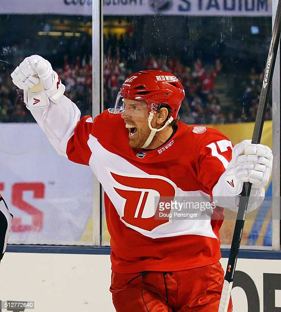 Brad Richards of the Detroit Red Wings scores the game winning goal at 19:00 of the third period against the Colorado Avalanche at Coors Field during...