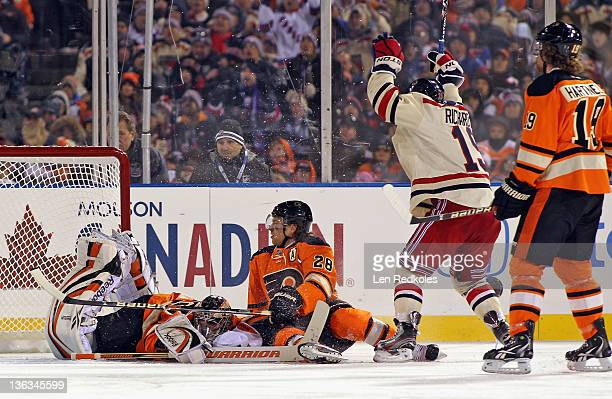 Brad Richards of the New York Rangers celebrates his game-winning goal against Sergei Bobrovsky and Claude Giroux of the Philadelphia Flyers during...