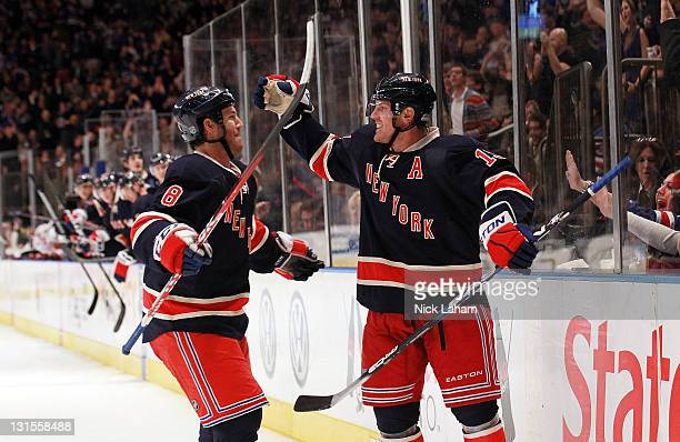 Brad Richards of the New York Rangers celebrates his goal with teammate Brandon Prust against the Montreal Canadiens at Madison Square Garden on...
